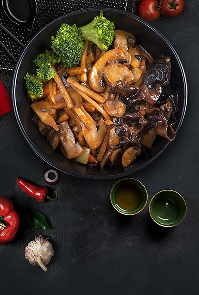 Young bamboo shoots fried with mushrooms