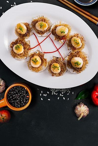Морские гребешки с чесночным соусом